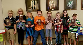 Third Graders receiving their new bibles.